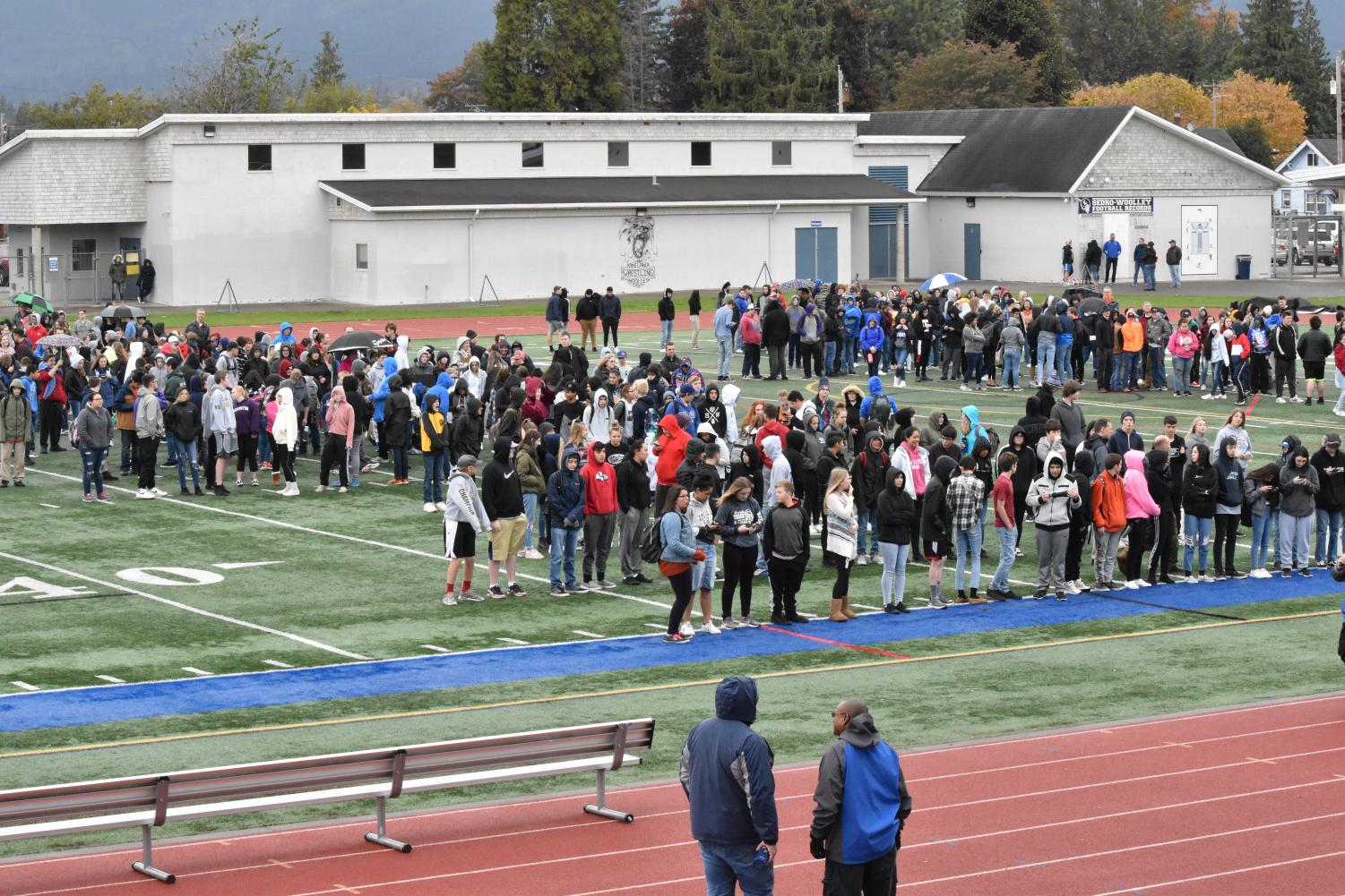 SWHS students gather on the field as they await further instruction. The statewide ShakeOut drill was deemed a success. Photo by Anna Ferdinand.