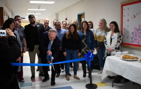 Sedro-Woolley School District members gather around on February 24 as Superintendent Phil Brockman cuts the Ribbon for the new Woolley Wellness Center.