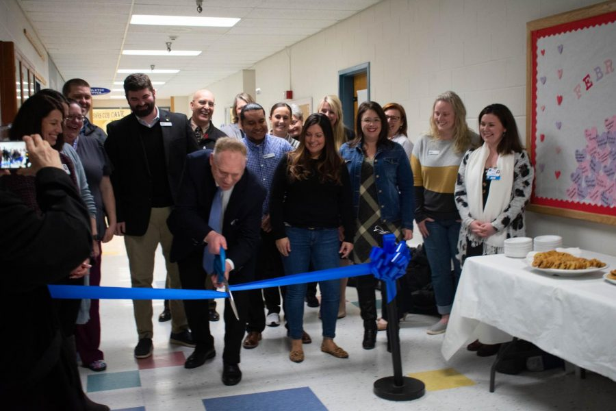 Sedro-Woolley+School+District+members+gather+around+on+February+24+as+Superintendent+Phil+Brockman+cuts+the+Ribbon+for+the+new+Woolley+Wellness+Center.+