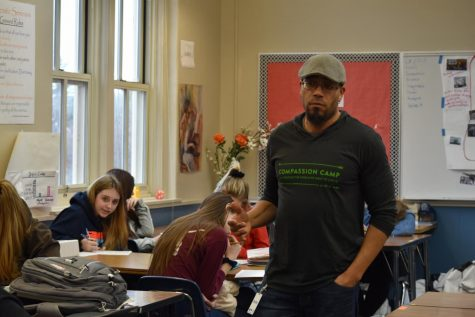 Daemond Arrindell teaches in Anna Ferdinand's tenth grade english class about the expression that can be allowed through poetry.  Arrindell's trip to Sedro was in collaboration with Skagit Rivrt Portry Foundstion, an organiszation that brings poets to work with students throughout Watcom and Skagit county. Photo by Camree Nilsen.