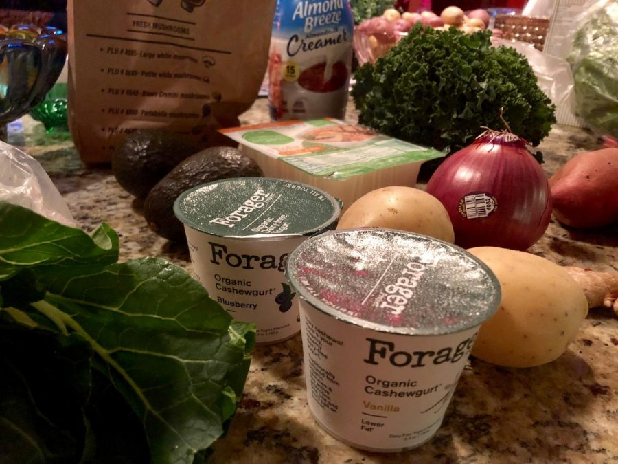 Some of Raven's vegan groceries for the week included kale, cashew yogurt, avocado,and almond milk.