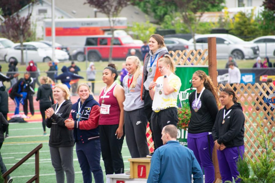 Makenna+Peterson+stands+on+podium+after+placing+second+in+state.