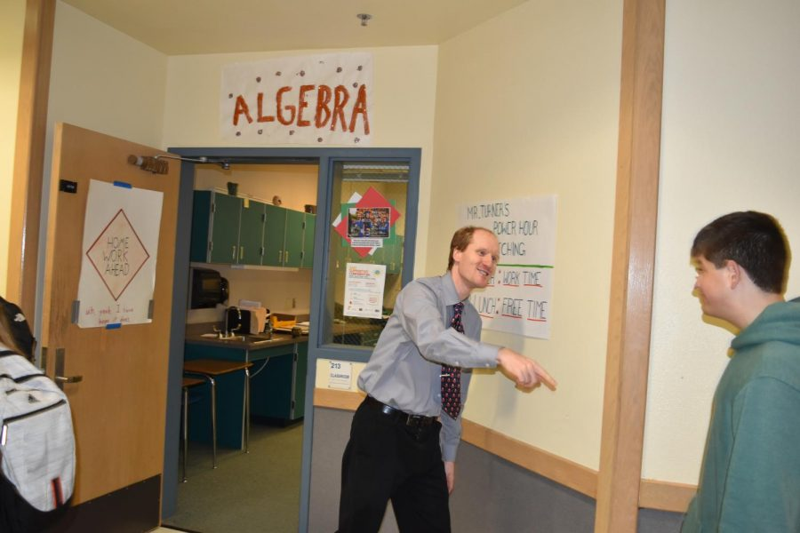 Words+of+Encouragement%2C+Mr.+Turner+smiles+as+he+engages+with+passing+students.