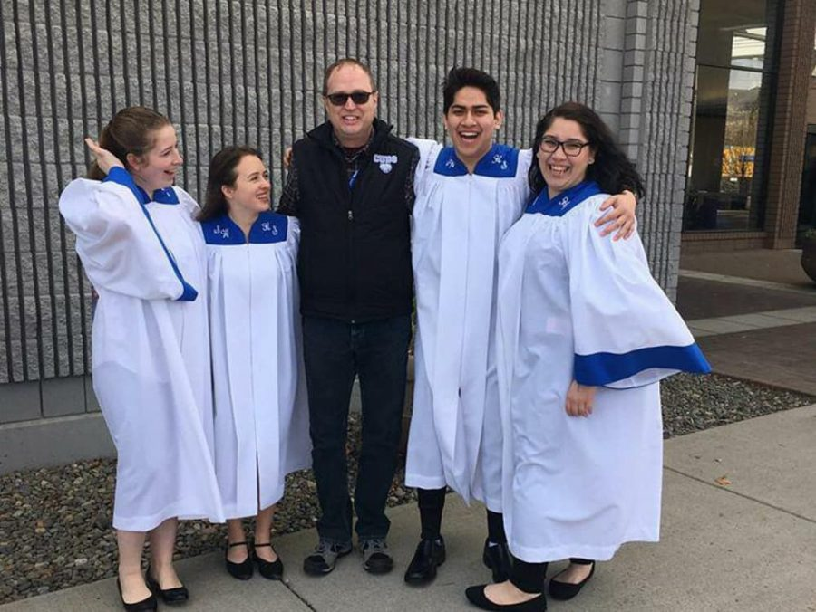 Sedro-Woolley High School seniors and vocal arts director Poul Brask stand outside the Yakima Convention Center after their concert February 16. These seniors qualified for the honor of the All-State choir in late November.  Photo courtesy of Serina Wilson
