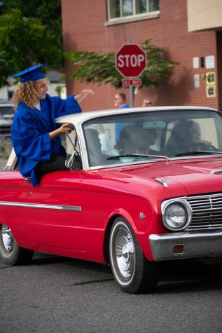 Jens Gifford waves during the 2020 Parade of Graduates June 5, 2020 in front of Sedro-Woolley High School.